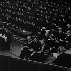 Primary view of object titled '[Faculty Staff seated at Commencement Ceremony]'.