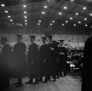 Primary view of object titled '[Young Men in Line to Receive Diplomas, 3]'.