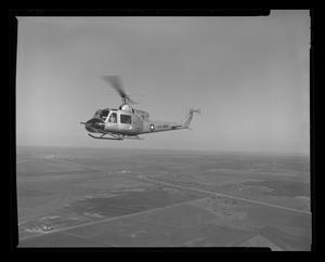 Primary view of object titled '[XH-40 #3 first flight over Hurst plant]'.