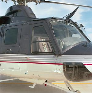 Primary view of object titled '[The outside of the cabin of the Bell 412SP]'.