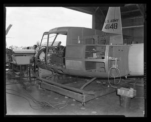 Primary view of object titled '[The XH-40 fuselage assembly in production]'.
