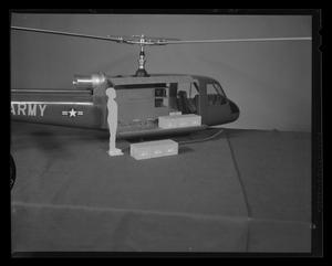 Primary view of object titled '[Scale model of an H-40 troop carrier with cargo and service man mockup]'.