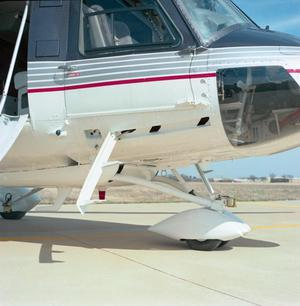 Primary view of object titled '[Lower portion of the cockpit and landing gear of the Bell 412SP]'.