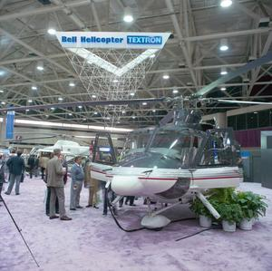 Primary view of object titled '[The Bell 412SP on display at a trade show]'.