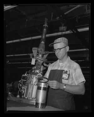 Primary view of object titled '[Bell employee working with the 204-010-175 nylon ring]'.