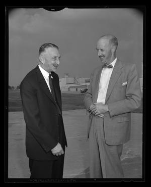Primary view of object titled '[Bart Kelley and Fred Forrer stand and talk on the Hurst heliport]'.