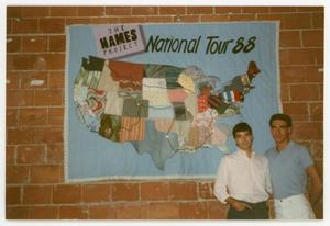 Primary view of object titled '[Two Men in Front of Quilted Tour Map]'.