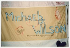Primary view of object titled '[Quilt Section with Dedication to Michael B. Wilson]'.