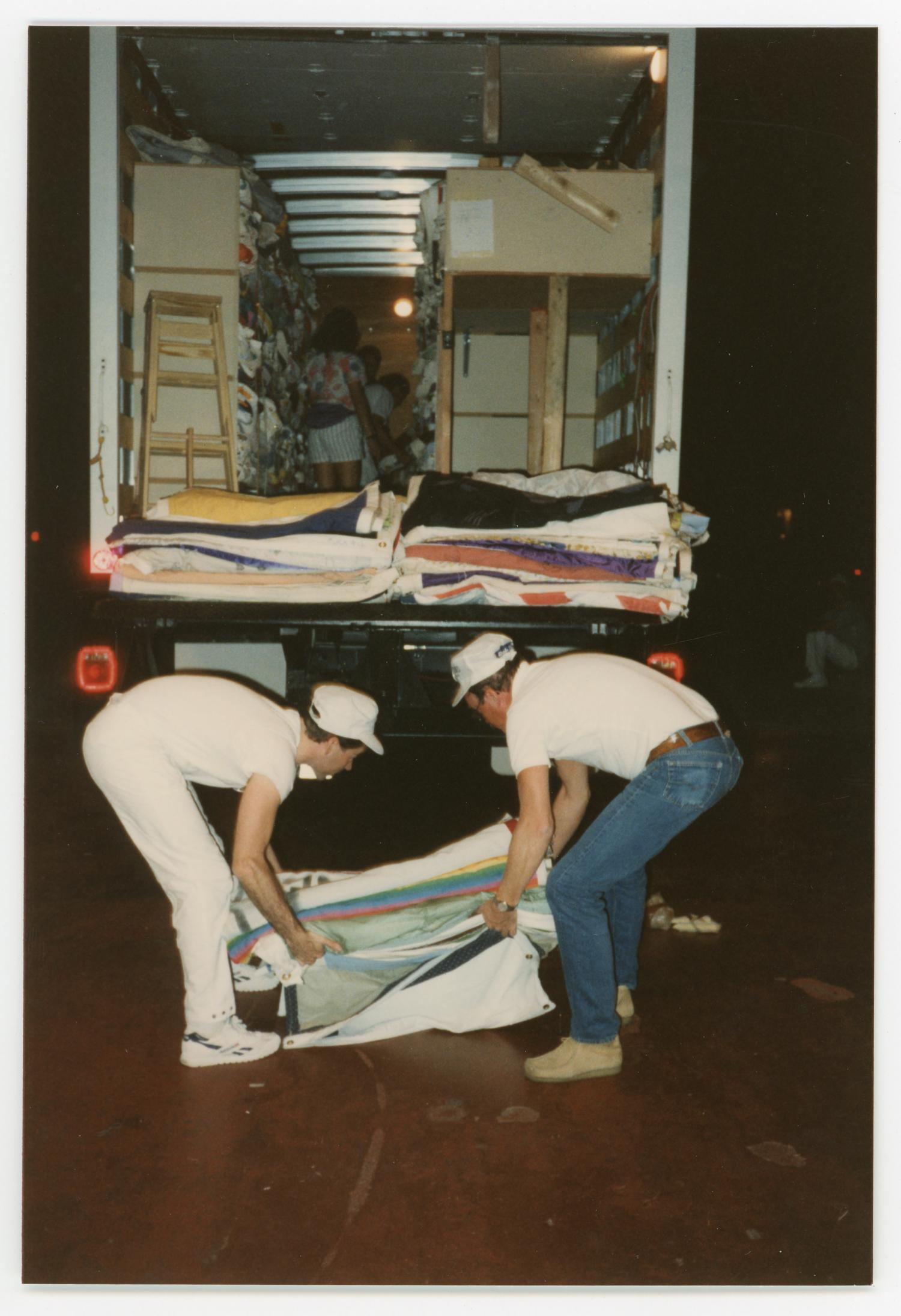 [Two Volunteer Workers Unloading AIDS Memorial Quilts]                                                                                                      [Sequence #]: 1 of 2