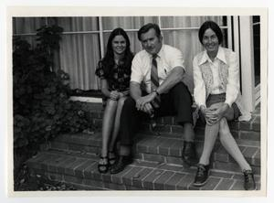 Primary view of object titled '[Three Persons Sitting Together on Steps]'.