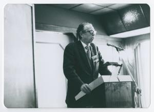 Primary view of object titled '[Dr. Richard H. Dolson Standing at Podium]'.