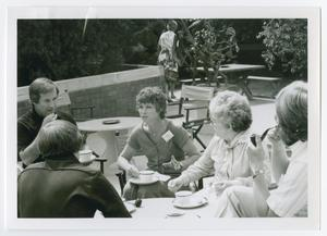 Primary view of object titled '[Group of Five Seated Outside with Cups of Tea]'.