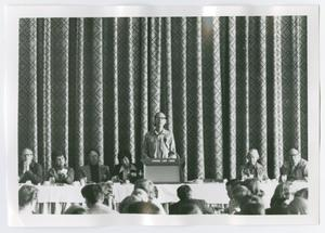 Primary view of object titled '[Man Speaking to Audience at Jackson Lake Lodge]'.
