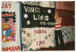 Primary view of object titled '[Man Standing Next to Quilt Panel for Vince Lewis]'.