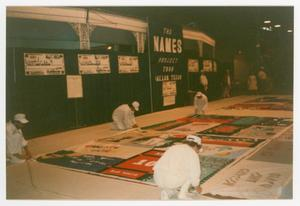 Primary view of object titled '[The Preparing of an AIDS Memorial Quilt by Four Members]'.