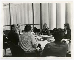Primary view of object titled '[A Group Discussion and Reviewing of Documents]'.