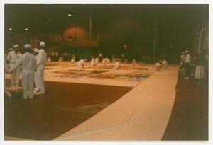 Primary view of object titled '[Members Gathered Together Around AIDS Memorial Quilt Panels]'.