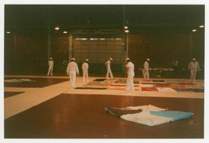 Primary view of object titled '[Group of Members Surveying Quilt Portion Before Event]'.