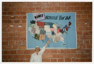 Primary view of object titled '[Worker Pointing At The Names Project National Tour 88 Quilt Map]'.