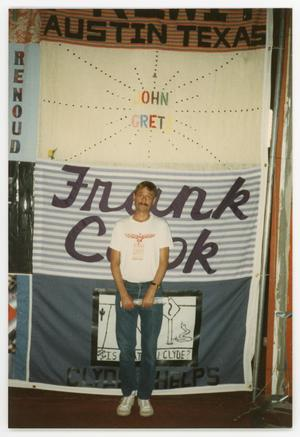 Primary view of object titled '[Man Standing In Front of AIDS Memorial Quilt Display]'.