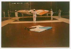 Primary view of object titled '[Crew Members Straightening Out Quilt Panels for Set Up]'.
