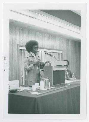 Primary view of object titled '[Marsha Darling Speaking at Podium]'.