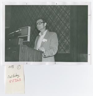 Primary view of object titled '[Ronald J. Grele Speaking at Podium]'.
