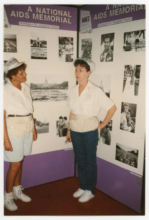 Primary view of object titled '[Two Women Standing at A National AIDS Memorial Display]'.
