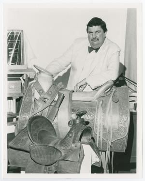 Primary view of object titled '[Lonn Taylor Pictured with Saddles]'.