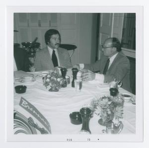 Primary view of object titled '[Two Men Conversing at Table]'.