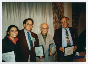 Primary view of object titled '[Four People Holding Oral History Association Certificates]'.