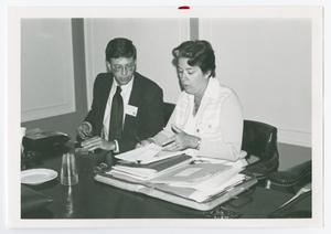 Primary view of object titled '[William N. Moss and Enid H. Douglass Reviewing Documents]'.