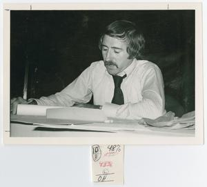 Primary view of object titled '[Ronald Marcello Looking Over Papers]'.