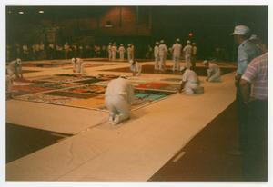 Primary view of object titled '[NAMES Project Members Preparing AIDS Memorial Quilt Display]'.