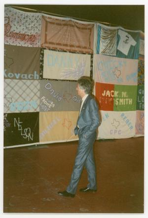 Primary view of object titled '[Man Observing AIDS Memorial Quilts]'.