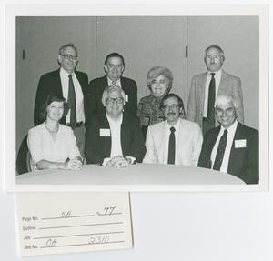 Primary view of object titled '[Eight OHA Members Seated at a Table]'.