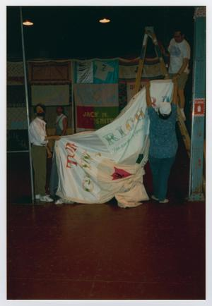 Primary view of object titled '[Members in Preparation for the AIDS Memorial Quilt Showing]'.