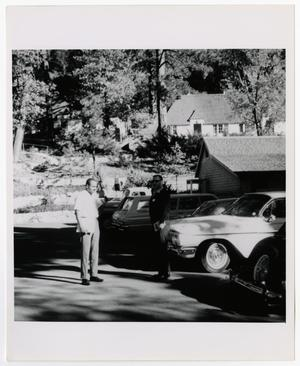 Primary view of object titled '[Two Men Standing in Parking Lot]'.