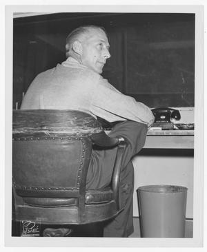 Primary view of object titled '[Stan Kenton at a desk]'.