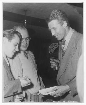 Primary view of object titled '[Stan Kenton and unidentified men]'.