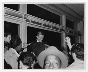 Primary view of object titled '[Kenton signing autographs at Schirmer opening]'.