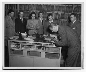 Primary view of object titled '[Kenton autographing record albums]'.