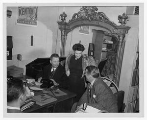Primary view of object titled '[Stan Kenton and record officials]'.