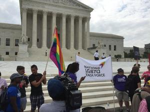 "Primary view of object titled '[Photo taken at the U.S. Supreme Court on Marriage Equality Day, a sign says ""National LGBTQ Task Force]'."