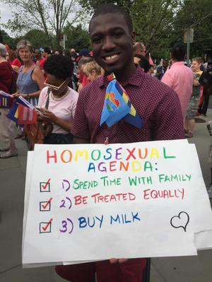 "Primary view of object titled '[Young man holding a sign ""Homosexual Agenda"" at the U.S. Supreme Court on Marriage Equality Day]'."