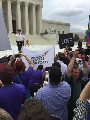 Primary view of object titled '[Running of the Interns at the U.S. Supreme Court on Marriage Equality Day, Lauren Langille in the lead]'.