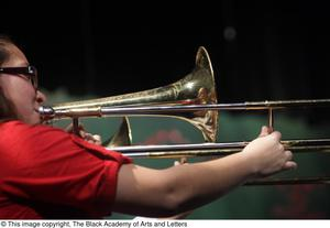 Primary view of object titled '[Close View of Unidentified Trombone Player]'.
