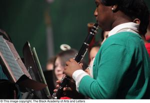 Primary view of object titled '[Unidentified Clarinet Player Performing on Stage]'.