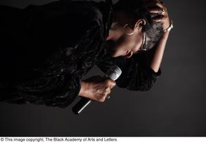 Primary view of object titled '[Unidentified Vocalist Performing on Stage]'.