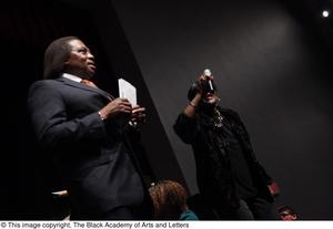 Primary view of object titled '[Curtis King on Stage with Singer]'.